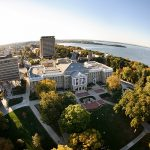 an aerial image of the UW Madison campus and Madison city.